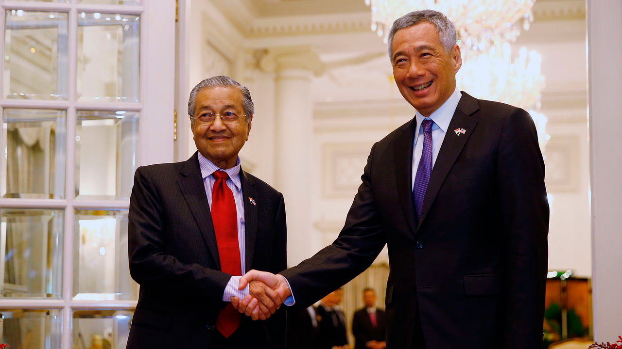 Dr M begins two-day official visit to Singapore