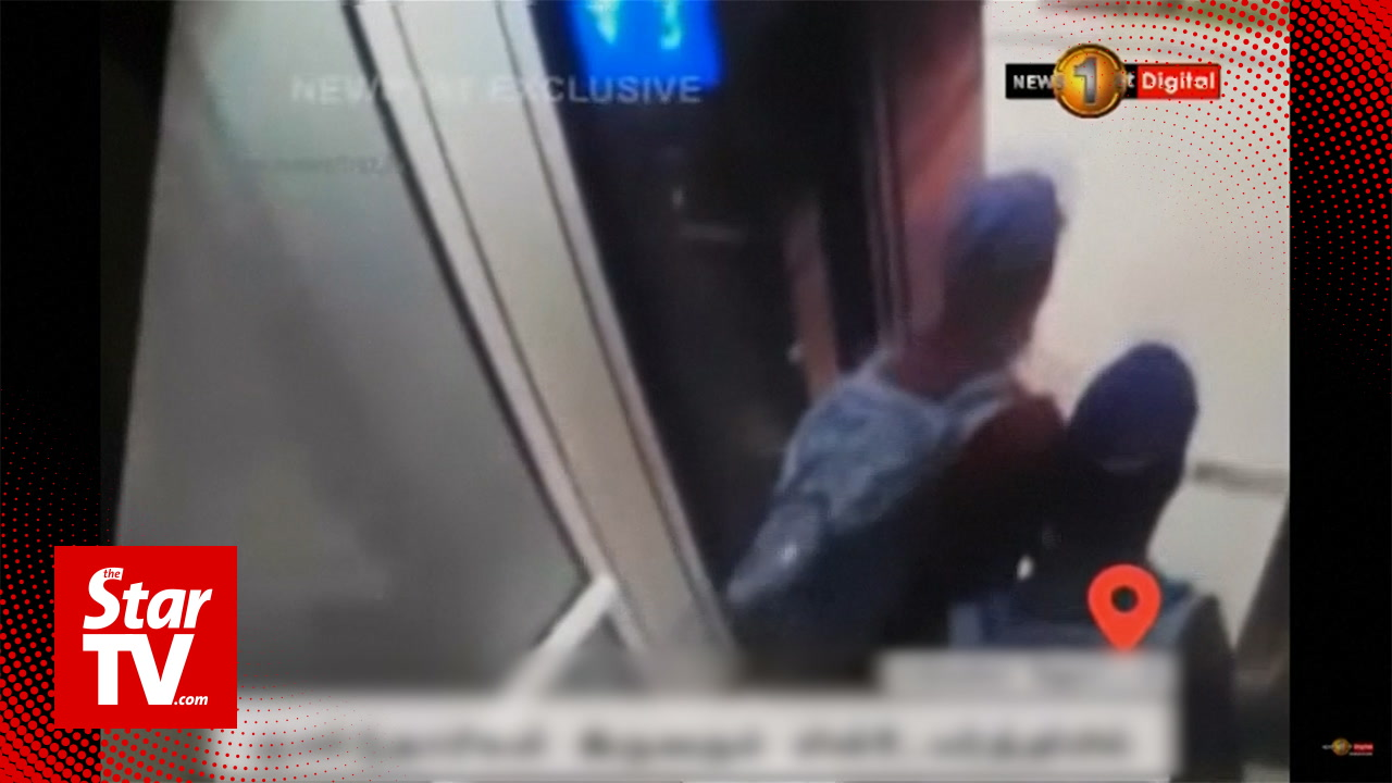 Surveillance video shows two suspected suicide bombers in hotel before blast