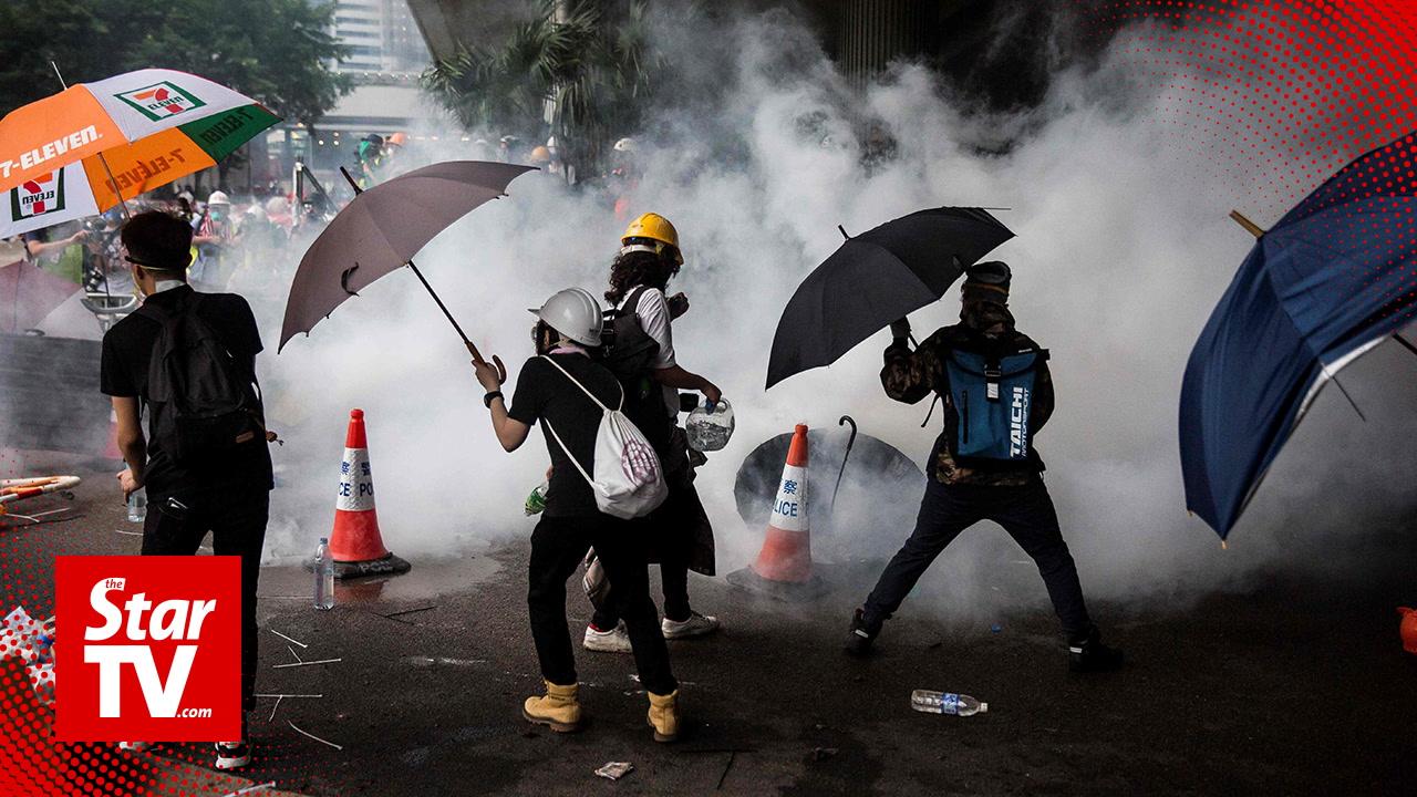 Hong Kong police fire tear gas at street demonstrators