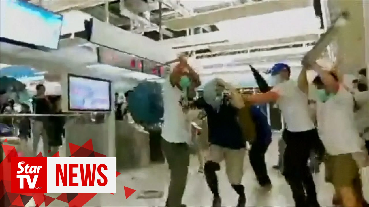 Reporter attacked while on-air by suspected triad gangsters in Hong Kong